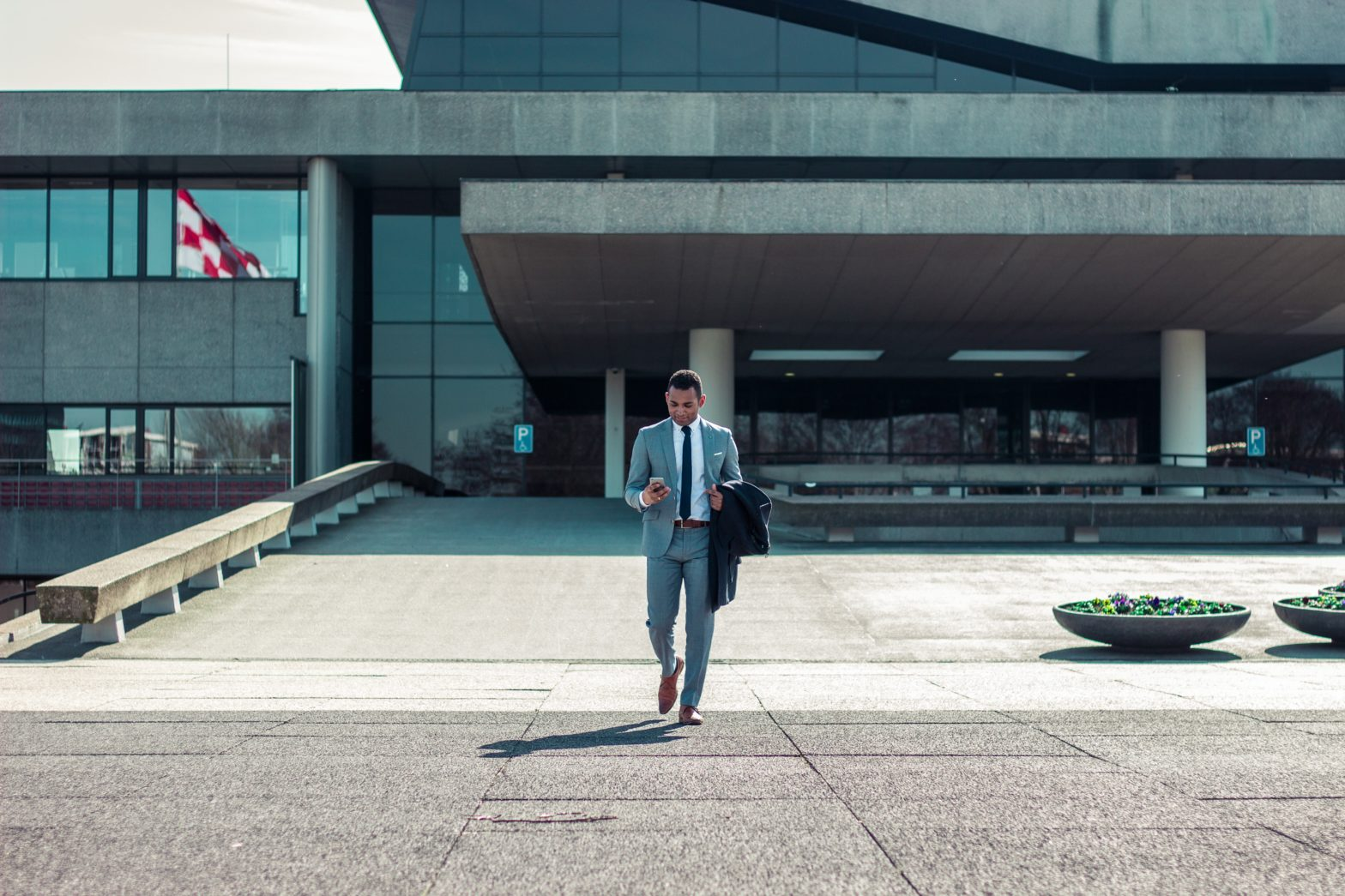 Man in suit in front of a building