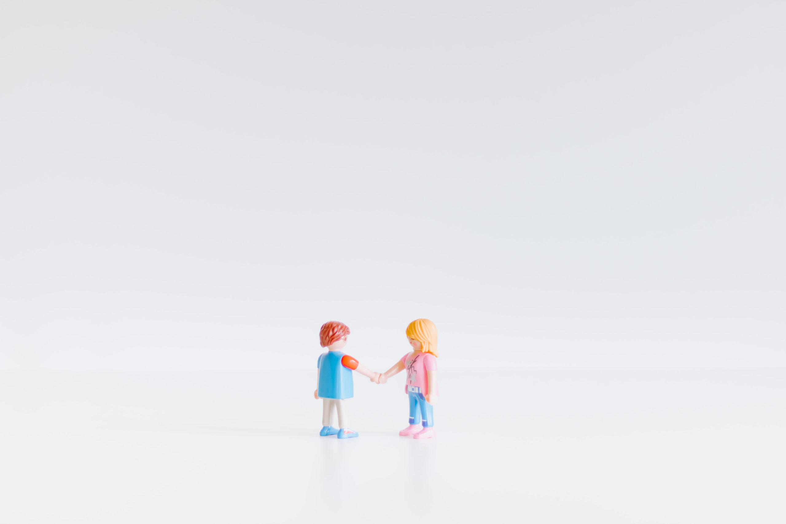 Two Lego dolls holding hands