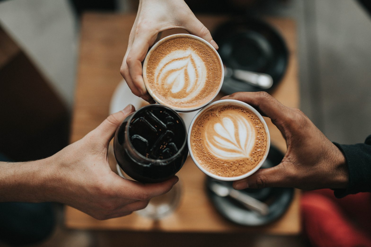 People toasting with lattes
